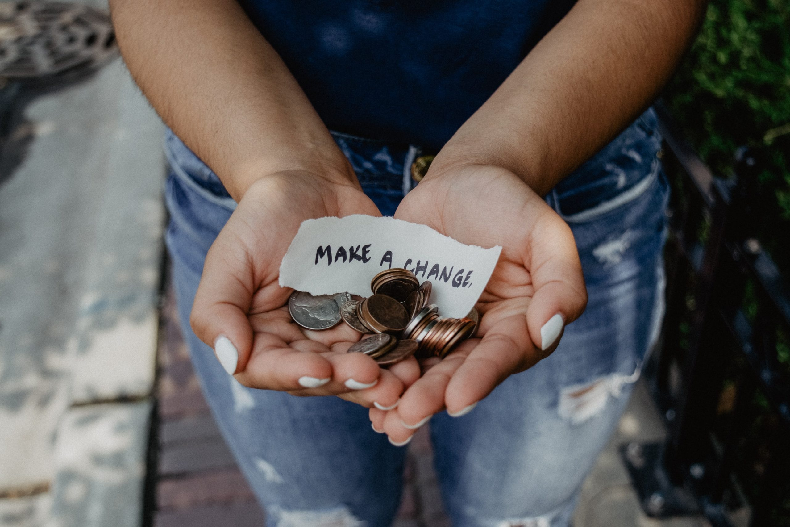 Hands holding Money. What are your priorities?